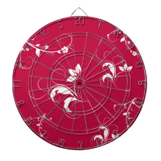 Red floral dartboard with darts