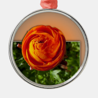 Red flower coming out of frame with a hint of yell round metal christmas ornament