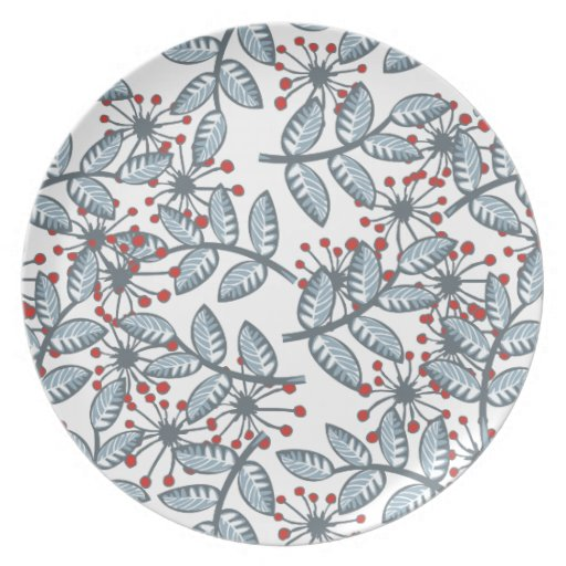 red flowers and blue leaves on white plate