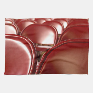 Red folding chairs towel