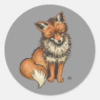 Red fox on grey background classic round sticker