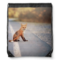 Red Fox Sitting on the side of the road Drawstring Backpack