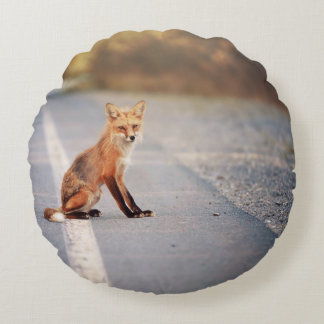 Red Fox Sitting on the side of the road Round Pillow