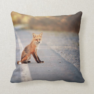 Red Fox Sitting on the side of the road Throw Pillows