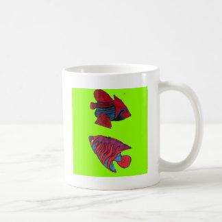 Red goldfishes live on a green aquarium coffee mug