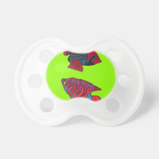 Red goldfishes live on a green aquarium pacifier