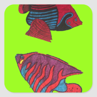 Red goldfishes live on a green aquarium square sticker