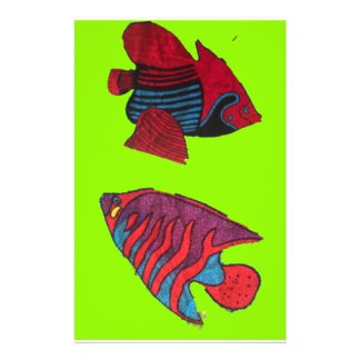 Red goldfishes live on a green aquarium stationery
