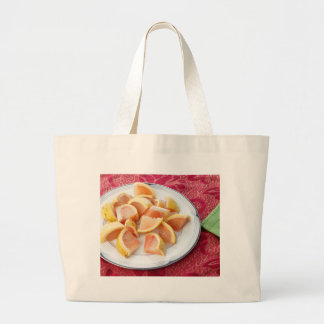 Red Grapefruit Pieces on a Round Plate Large Tote Bag