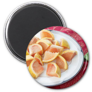 Red Grapefruit Pieces on a Round Plate Magnet