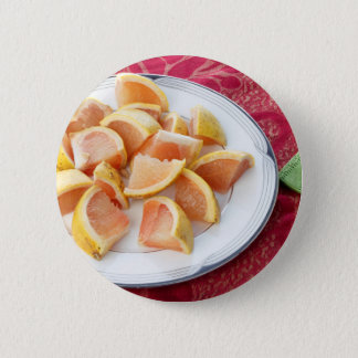 Red Grapefruit Pieces on a Round Plate Pinback Button