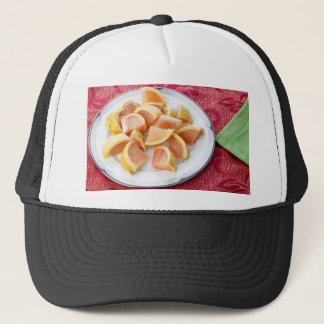 Red Grapefruit Pieces on a Round Plate Trucker Hat