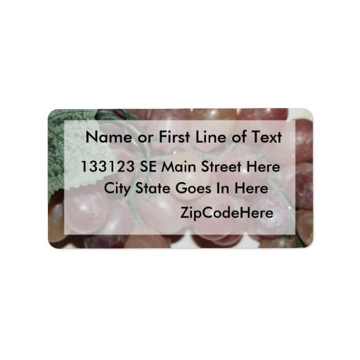 Red grapes, plastic, on pale background address label
