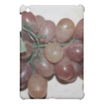 Red grapes, plastic, on pale background cover for the iPad mini