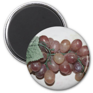 Red grapes, plastic, on pale background fridge magnets
