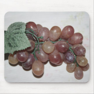 Red grapes, plastic, on pale background mousepad