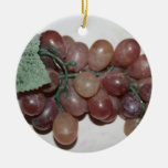 Red grapes, plastic, on pale background christmas ornament