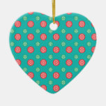 Red green snowflakes in circles on turquoise christmas ornament