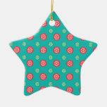 Red green snowflakes in circles on turquoise christmas tree ornaments