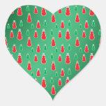 Red green snowmen on green fade heart sticker