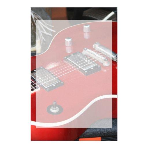 Red guitar on amp stationery design