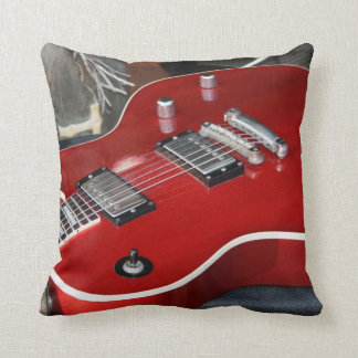 Red guitar on amp throw pillow