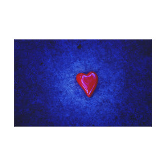 red heart on blue canvas prints