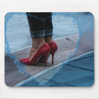 Red high heel shoes on a mousepad