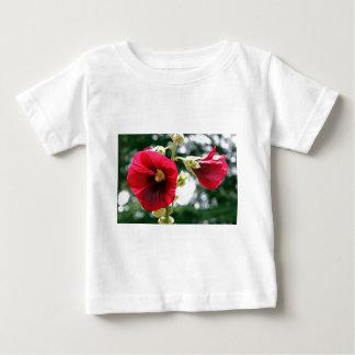 Red Hollyhock flowers in bloom Baby T-Shirt