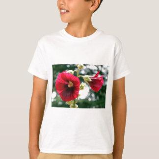 Red Hollyhock flowers in bloom T-Shirt