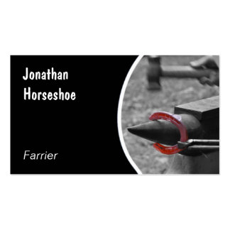 Red horseshoe hammered on an anvil business card