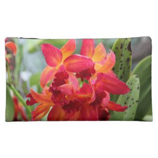 Red Hued Orchids Makeup Bag