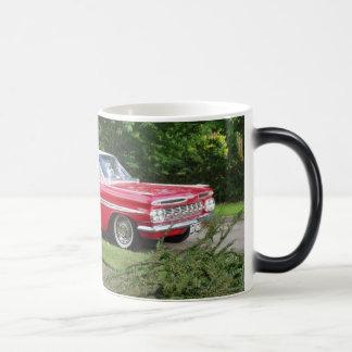 red impala with greenery background mug