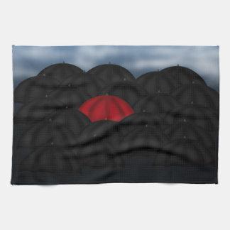 Red in a Black Sea of Umbrellas Kitchen Towel
