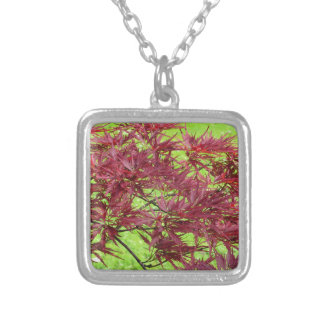 Red japanese maple leaves on green background silver plated necklace