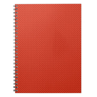 Red knitting wool texture background notebook