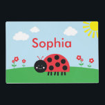 "Red Ladybug Personalized Placemat<br><div class=""desc"">A great gift for the ladybug lover in your life. Little ones will love eating meals with their own personalized placemat!  This placemat features a sweet,  smiling red ladybug on a hill with red and pink flowers.</div>"
