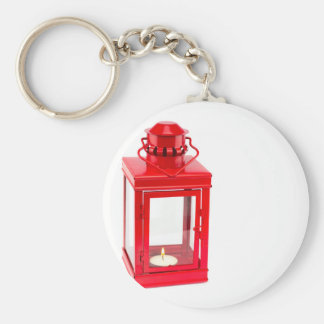 Red lantern with burning tealight on white keychain