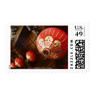 red lanterns hanging from temple roof postage