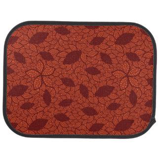 Red leaves pattern on orange car mat