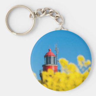 Red lighthouse in a yellow canola field basic round button keychain