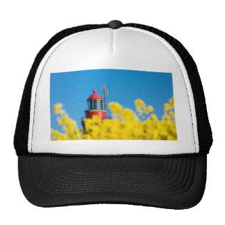 Red lighthouse in a yellow canola field trucker hat