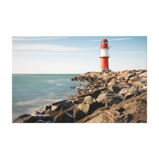 Red lighthouse in Warnemuende Canvas Print