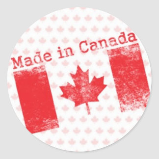 Red Made in Canada Stamp on Maple Leaf Background Classic Round Sticker