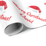 """Red Merry Christmas Santa Hat wrapping paper<br><div class=""""desc"""">Red Merry Christmas Santa Hat wrapping paper. Customize Name or Wordings. Perfect for Christmas or Holiday gift-wrapping and crafting. For further customization,  please click the """"Customize it"""" button and use our design tool to modify this template.</div>"""
