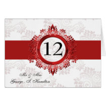 red monogram table seating card