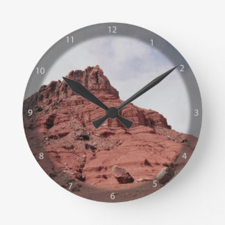 Red mountain against the sky wallclock