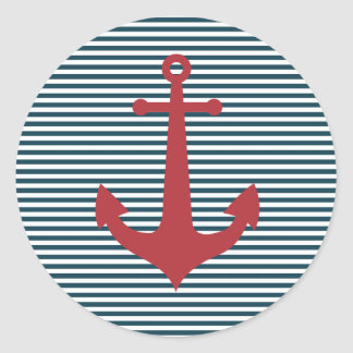 Red nautical anchor on striped blue background classic round sticker