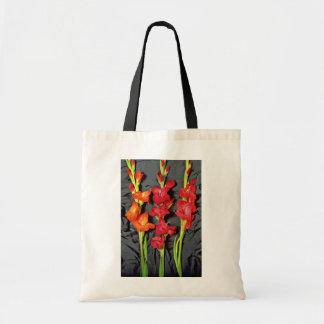 Red, orange and scarlet gladiolus  flowers tote bag