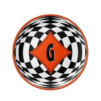 Red-Orange Medallion Over Black and White Diamonds Dinner Plate